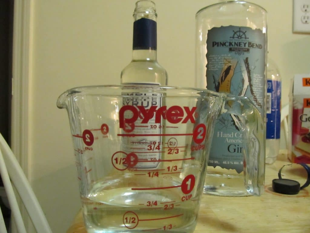 Adding the gin! (and simple syrup)